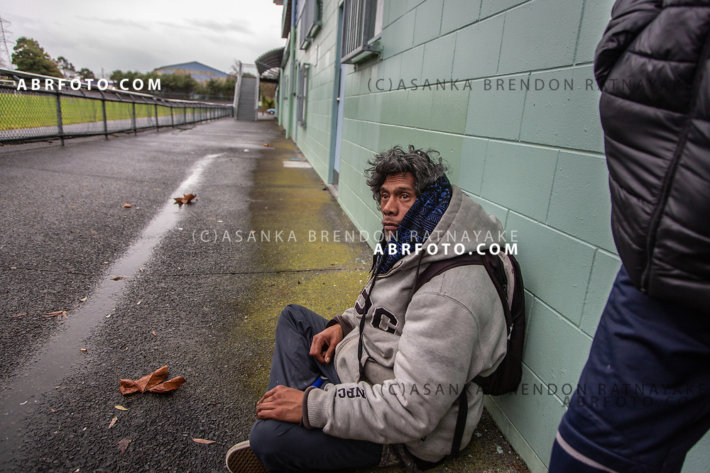 Joseph Takairangi sits down and rests at the 'Olympic Park' sports oval in the suburb of New Lynn, west of Auckland on the 6th of June 2018. Joseph Takairangi suffers from Asthma and prone to Asthma attacks during the cold winter periods. Asanka Brendon Ratnayake for The New York Times.