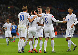 Theo Walcott ( 2nd L ) of England celebrates with team mates after he scores the opening goal - Mandatory byline: Paul Terry/JMP - 07966 386802 - 09/10/2015 - FOOTBALL - Wembley Stadium - London, England - England v Estonia - European Championship Qualifying - Group E