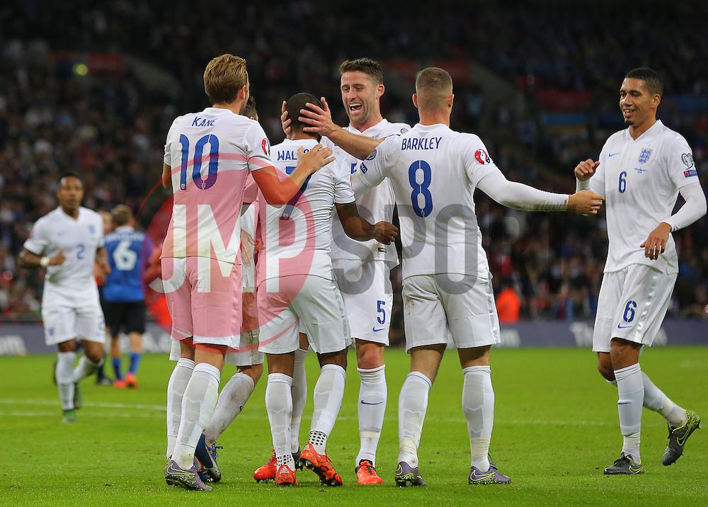 Theo Walcott ( 2nd L ) of England celebrates with team mates after he scores the opening goal - Mandatory byline: Paul Terry/JMP - 07966 386802 - 09/10/2015 - FOOTBALL - Wembley Stadium - London, England - England v Estonia - European Championship Qualifying - Group E