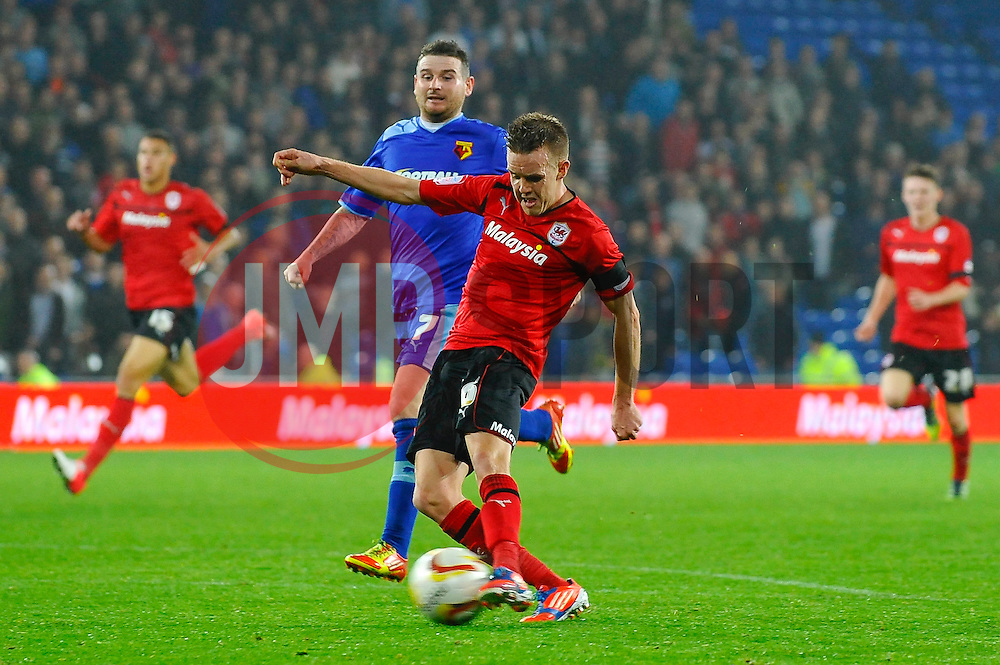 Cardiff Midfielder Craig Noone (ENG) strikes during the second half of the match - Photo mandatory by-line: Rogan Thomson/JMP - Tel: Mobile: 07966 386802 23/10/2012 - SPORT - FOOTBALL - Cardiff City Stadium - Cardiff. Cardiff City v Watford - Football League Championship
