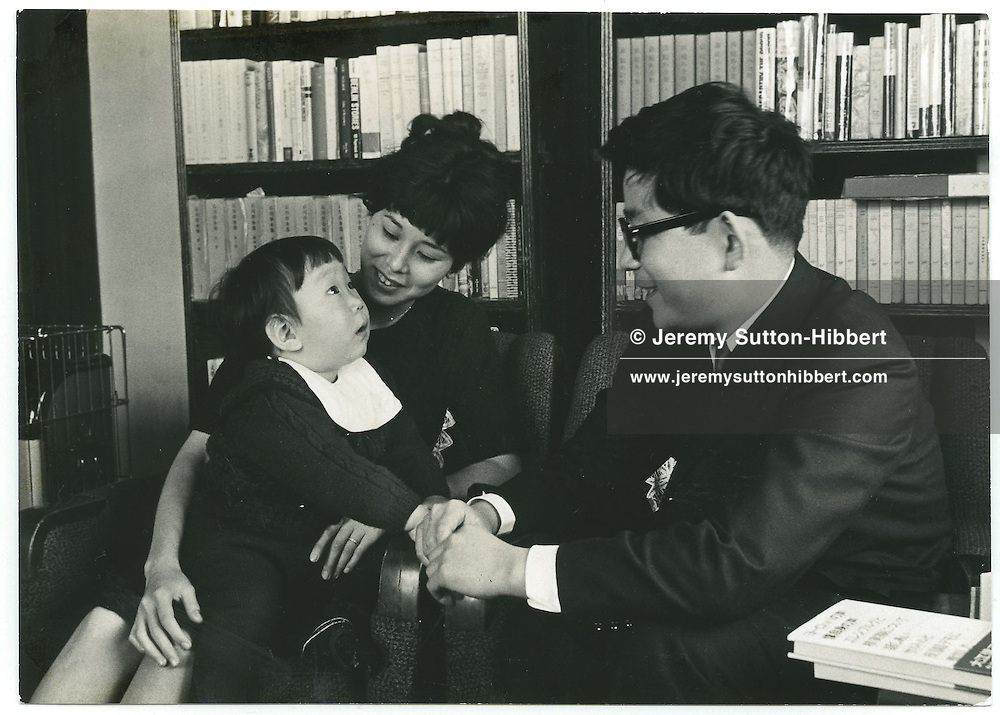 Kenzaburo Oe, Japanese author/essayist/novelist, with wife, and son, Hikari. .Born 1935, winner of 1994 Nobel Prize for Literature. Father of Hikari Oe, composer. Tokyo, Japan.