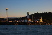 The Point Wilson Light stands at the edge of the Strait of Juan de Fuca near Port Townsend, Washington. The lighthouse was activated December 15, 1879. Its present structure was finished in 1913. The Point Wilson Light was automated in November 1976.