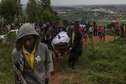 Men carry the casket of Emmanuel Cyuzuzo, 22, who passed away before receiving surgery to replace his aortic valve.<br /> <br /> Rheumatic heart disease is damage to one or more heart valves that stems from inadequately treated strep throat. Left untreated, rheumatic heart disease leads to heart failure.