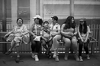 From left, Emilia Navas, Emily Mu&ntilde;oz, 13, Carlos Mu&ntilde;oz, 9, Yesenia Navas, Ana Cabrera and Estefania Cabrera wait for a train at the recently renovated Washington and Wabash stop.<br />