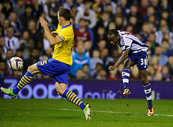 West Brom Forward Saido Berahino shoots past Arsenal Defender Thomas Vermaelen (BEL) during the second half of the match - Photo mandatory by-line: Rogan Thomson/JMP - Tel: 07966 386802 - 25/09/2013 - SPORT - FOOTBALL - The Hawthorns - West Bromwich Albion v Arsenal - Capital One Cup Round 3.