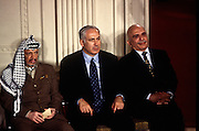 PLO leader Yasser Arafat, Israeli Prime Minister Benjamin Netanyahu and King Hussein of Jordan look on at a White House news conference October 2, 1996 In Washington, DC.