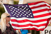 12 JUNE 2010 - PHOENIX, AZ: Sharon Sullins from Glendale, AZ, brought an American flag to the rally in support of SB 1070 at Bolin Memorial Park near the State Capitol in Phoenix Saturday. About 500 people, many from California and Florida, came to Bolin Memorial Park in Phoenix Saturday. The pro SB 1070 rally was sponsored by Tea Party.   PHOTO BY JACK KURTZ