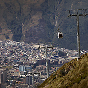 Cable cars, which climb to more that 13,000 feet up the slopes of Cruz Loma, carry tourists to spectacular views of surrounding volcanoes and of the ancient capitol city of Quito, Ecuador on July 18, 2009.
