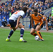 Scott Golbourne on the ball looking to skip past Lawrie Wilson during the Sky Bet Championship match between Bolton Wanderers and Wolverhampton Wanderers at the Macron Stadium, Bolton, England on 12 September 2015. Photo by Mark Pollitt.