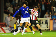 London - Tuesday, 21st September, 2010: Michael Spillane of Brentford and Marouane Fellani of Everton during the Carling Cup 3rd Round match at Griffin Park, London...Pic by: Alex Broadway/Focus Images