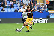 Bolton Wanderers defender Lewis Buxton (2) and Bradford City striker Billy Clarke (10) battle for the ball  during the EFL Sky Bet League 1 match between Bolton Wanderers and Bradford City at the Macron Stadium, Bolton, England on 24 September 2016. Photo by Simon Brady.