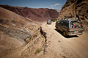Minibuses make their way toward Bamiyan along a narrow, unpaved stretch of road west of Wardak Province.