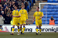 Photo: Daniel Hambury.<br />Reading v Cardiff City. Coca Cola Championship.<br />02/01/2006.<br />Cardiff's  L-R Joe Ledley, Glenn Loovens and Kevin Cooper discuss where things have gone wrong after they concede a second goal.