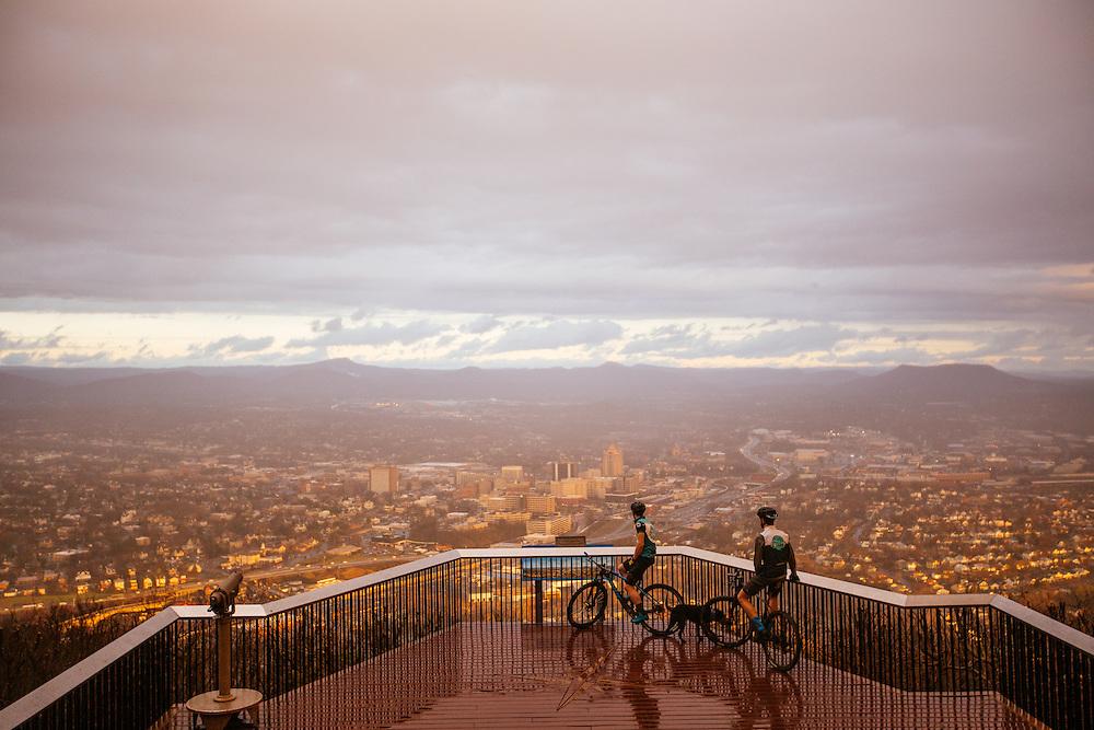 Gordon Wadsworth and Andrew Dunlap mountain biking on trails on Mill Mountain in the Blue Ridge Mountains around Roanoke, Virginia. Mountain biking in the Blue Ridge Mountains.