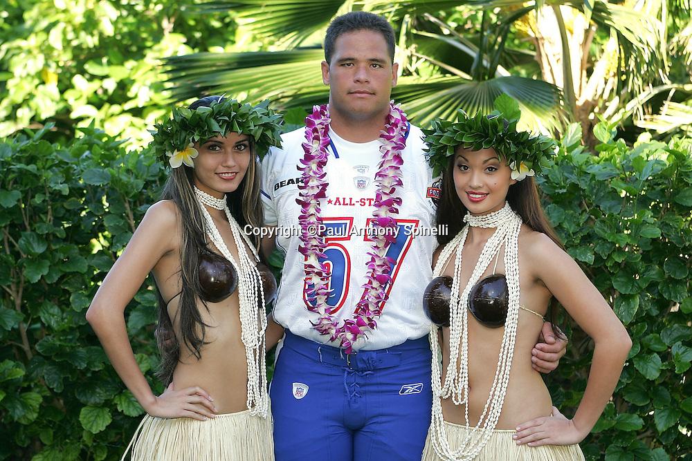 KO OLINA - FEBRUARY 11:  NFC Chicago Bears 2005 NFL Pro Bowl All-Stars Olin Kreutz #57 poses with Hawaiian Hula girls for his 2005 NFL Pro Bowl team photo on February 11, 2005 in Ko Olina, Hawaii. ©Paul Anthony Spinelli