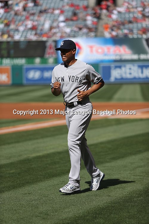 ANAHEIM, CA - JUNE 15:  Mariano Rivera #42 of the New York Yankees jogs while warming up before the game against the Los Angeles Angels of Anaheim on Saturday, June 15, 2013 at Angel Stadium in Anaheim, California. The Angels won the game 6-2. (Photo by Paul Spinelli/MLB Photos via Getty Images) *** Local Caption *** Mariano Rivera