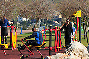 Israel, Haifa, Winter activity on the beach Outdoor public sport park with exercise machines
