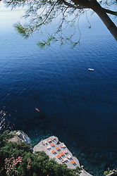Europe, Italy, Salerno, Amalfi Coast, resort with lounge chairs and Tyrrhenian Sea, viewed from cliff above