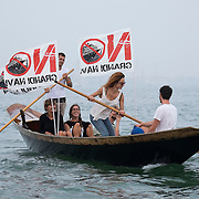Venetians take part in an environmental protest on the waters of the Lagoon against  big cruises and the digging of the new Contorta Canal in Venice<br /> <br /> HOW TO LICENCE THIS PICTURE: please contact us via e-mail at sales@xianpix.com or call our office in London +44 (0)207 1939846 for prices and terms of copyright. First Use Only ,Editorial Use Only, All repros payable, No Archiving.© MARCO SECCHI