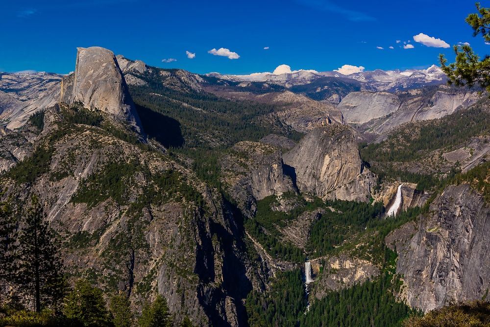 Half Dome (on left), Liberty Cap with Nevada Fall (above) and Vernal Fall (below), Yosemite National Park, California USA.