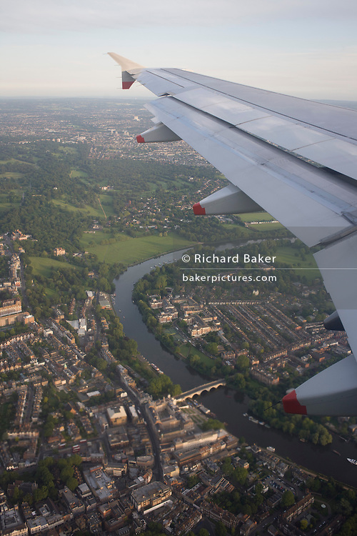 Window seat view of mid-Channel airliner wing and airspace over Richmond, west London.