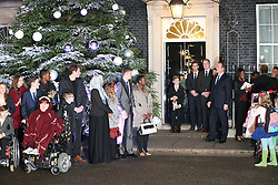 © Licensed to London News Pictures. 10/12/2015. London, UK. British Prime Minister DAVID CAMERON is joined by Points of Light award winners as he unveils this year's Downing Street Christmas tree. Photo credit: Peter Macdiarmid/LNP