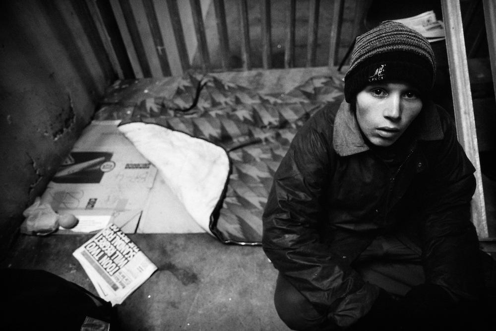 Homeless beggar where he sleeps in an underground car park, Birmingham, West Midlands, England, UK.