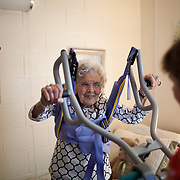 NURSING HOME<br /> <br /> Alice Jacobs, 90, is assisted into her wheelchair by Certified Nursing Assistants (CNA) Lisa Settle (red shirt) and Treeousha Banks (not shown) at the Dogwood Village assisted living facility Friday, June 23, 2017, in Orange, VA.  Jacobs once owned a factory and horses, raised four children and buried two husbands.  But years in an assisted living facility drained her savings, and now, she relies on Medicaid to pay for her care.<br /> <br /> Photo by Khue Bui