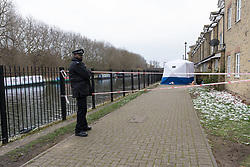 © Licensed to London News Pictures. 19/03/2018. London, UK. Police at the scene in Towpath Walk in Hackney this morning, where a murder investigation has been launched. Police were called at around 8:16am on Sunday 18th March to reports of a man with stab wounds on Towpath Walk, E9 in Hackney, east London. A man aged 42 was found with multiple injuries and pronounced dead at the scene.. Photo credit: Vickie Flores/LNP