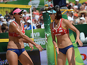 STARE JABLONKI POLAND - July 6:  Chen Xue and Xi Zhang of China in action during Day 6 of the FIVB Beach Volleyball World Championships on July 6, 2013 in Stare Jablonki Poland.  (Photo by Piotr Hawalej)