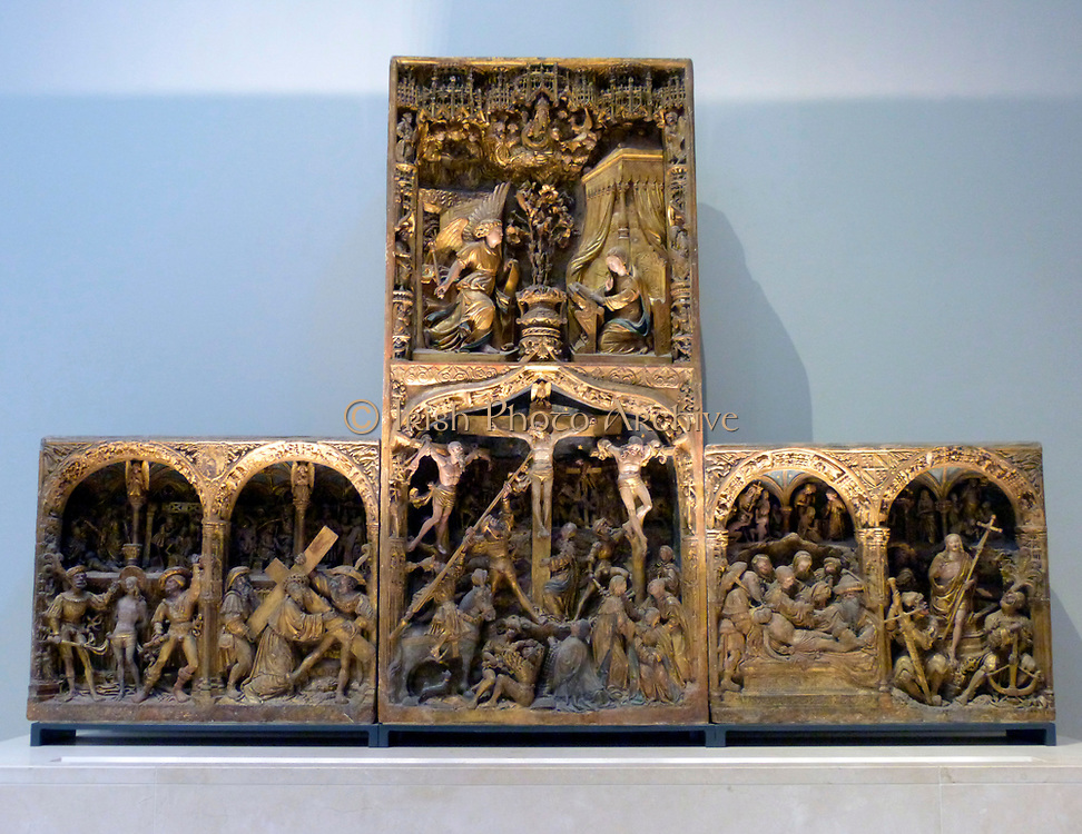 The Troyes Altarpiece circa 1525 (limestone, painted and gilded) was made for Jean Huynard the Elder, a lawyer who was elected dean of the chapter of Lirey in 1504.  Amid the scenes of Christ's arrest, death and resurrection, Jean can be found kneeling at the foot of the cross.  His family shields appear in the spandrels between the arches on the left and right sides.