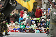 Goshen, New York - Children and adults watch marchers in the mid-Hudson St. Patrick's Day parade on March 13, 2011. ©Tom Bushey / The Image Works