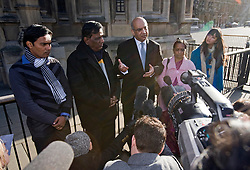 © Licensed to London News Pictures. 04/01/2012. London, UK.  L to R RAKESH SONAWANE (Brother-in-law), SUBHASH BIDVE (Father), Keith Vaz (Leicester MP) and YOGINI BIDVE (mother) speaking outside the Houses of Parliament London on January 4th, 2012 after arriving in the UK from Mumbai. The Family of 20 year-old ANUJ BIDVE, are expected to travel to Manchester to visit the scene where ANUJ was shot dead.  Photo credit: Ben Cawthra/LNP