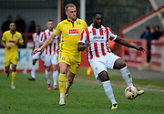 Pablo Mills plays a back pass during the Sky Bet League 2 match between Cheltenham Town and Plymouth Argyle at Whaddon Road, Cheltenham, England on 28 March 2015. Photo by Alan Franklin.