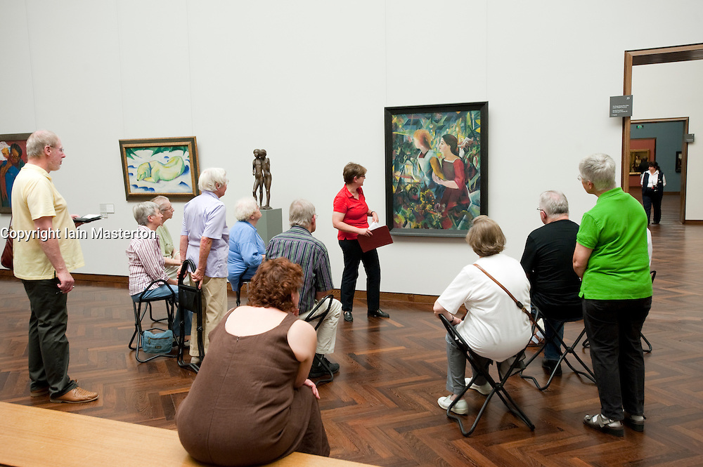 Tour group listening to art expert at Stadel art museum or Städelsches Kunstinstutut in Frankfurt Germany