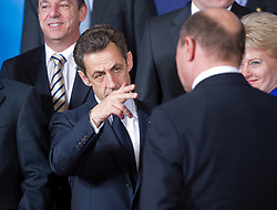 Nicolas Sarkozy, France's president, center, speaks with Donald Tusk, Poland's prime minister, (back to camera) as Dalia Grybauskaite, Lithuania's president,  far right, and Lawrence Gonzi, Malta's prime minister, far left, look on, during the European Summit, in Brussels, on Thursday, March 25, 2010. (Photo © Jock Fistick)