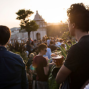 April 12, Lisbon, Portgual : People drink and take in the sunset at the rooftop car park bar, PARK, in downtown Lisbon, Portugal. CREDIT: Karsten Moran / Redux Pictures