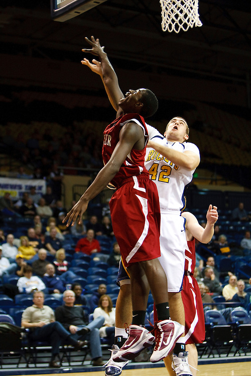 2 December 2009:  Rochester's Dramell Hogan (21) and Toledo's Jordan Dressler (42) during the NCAA basketball game between Rochester Warriors and the Toledo Rockets at Savage Arena in Toledo, OH.