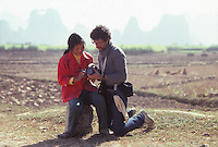 Owen Franken showing his camera to a Chinese girl, in Yangshuo, China