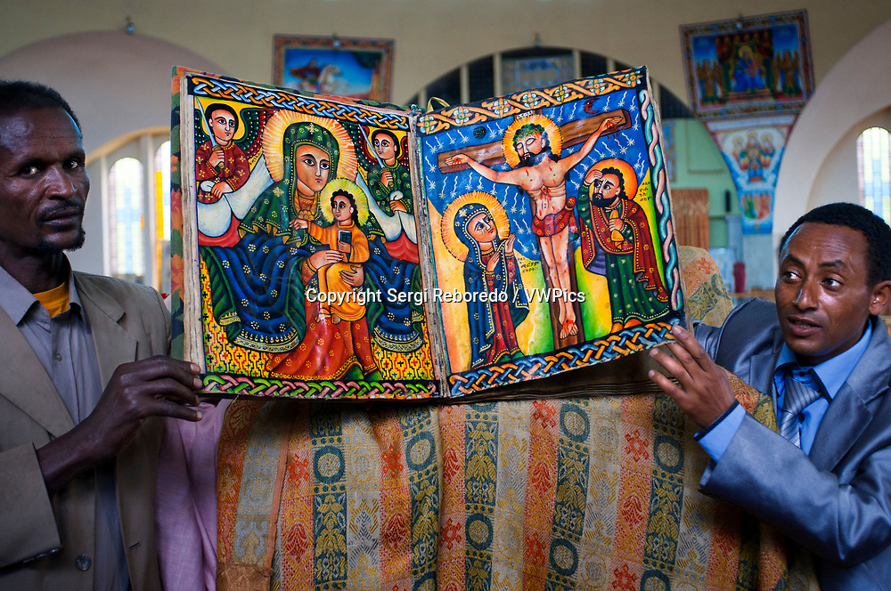 St Mary of Zion church, Aksum, Ethiopia. Priests show the sacred books of the new church of St Mary of Zion in Axum. Ethiopian churches have several entrances: the southern entrance for women and the north for men; The east can be used interchangeably. Built according to a scheme inspired by the Temple of Solomon, they have three parts: a choir, a sacred space where the Eucharist is distributed and a closed sanctuary accessible only to priests.