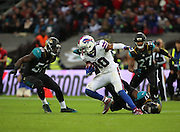 Buffalo Bills Robert Woods trying to dodge tackles during the Buffalo Bills v Jacksonville Jaguars NFL International Series match at Wembley Stadium, London, England on 25 October 2015. Photo by Matthew Redman.