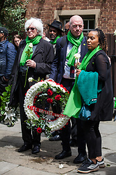 London, UK. 14 June, 2019. Matt Wrack, General Secretary of the Fire Brigades Union, joins family members to walk in silence to lay tributes at the foot of the Grenfell Tower following a memorial service at St Helen's Church to mark the second anniversary of the Grenfell Tower fire on 14th June 2017 in which 72 people died and over 70 were injured.