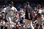 Bruce Bochy is taking the ball from Javier Lopez during the MLB game between the San Francisco Giants and the San Diego Padres, at AT&amp;T Park in San Francisco, CA.<br /> The Giants won 13-8 in 9 innings.<br /> Credit : Glenn Gervot