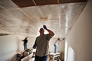 Master Sgt. Brad Bush, applies the first coat of white paint on the ceiling of what will be a reception room. The Devine, Tex. native is deployed to the 276th Expeditionary Logistics Readiness Squadron from the 509th Bomb Wing. The Bishkek International Womens Club describes the home as being at the foot of the snow-decked mountains of the Tien-Shan range in the little village Kok Jar [.. over the o] (Schar) just outside Bishkek, Kyrgyz Republic, there used to be a small center where groups of handicapped children could receive therapeutic treatment over a periods of three weeks and where 8-10 homeless disabled children used to live. This center was part of the Hadjeshda Children?s Center, today housing more than 60 children and teenagers. However, in April 2004 the roof burned down and the other parts of the house were badly damaged.  Today more than 120 children are still waiting for the center to re-open. (U.S. Air Force photo by Master Sgt. Lance Cheung)<br />