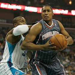 Apr 07, 2010; New Orleans, LA, USA; Charlotte Bobcats forward Boris Diaw (32) drives in against New Orleans Hornets forward David West (30) during the first half at the New Orleans Arena. Mandatory Credit: Derick E. Hingle-US PRESSWIRE