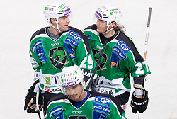 Anze Ropret, Ziga Pavlin and Tomi Mustonen of Olimpija celebrate after 1st goal during ice-hockey match between HDD Tilia Olimpija and HK Acroni Jesenice in 26th Round of EBEL league, on December 10, 2010 at Hala Tivoli, Ljubljana, Slovenia.(Photo By Vid Ponikvar / Sportida.com)