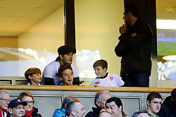 David Beckham and his sons Romeo, Brooklyn and Cruz  look on from the South West stand hospitality during the second half of the match - Photo mandatory by-line: Rogan Thomson/JMP - Tel: Mobile: 07966 386802 09/11/2013 - SPORT - RUGBY UNION -  Twickenham Stadium, London - England v Argentina - QBE Autumn Internationals.