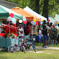 Area families gather on the lawn of the Family Resource Center in Tupelo for their fifth annual Child Safety Day on Monday afternoon.