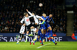Derby County and Leicester City players challenge to get on the end of a cross - Mandatory by-line: Robbie Stephenson/JMP - 08/02/2017 - FOOTBALL - King Power Stadium - Leicester, England - Leicester City v Derby County - Emirates FA Cup fourth round replay