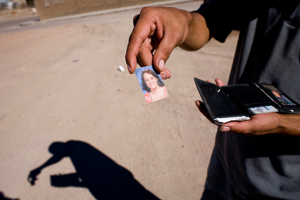 A migrant from Honduras shows a photo of his American girlfriend in Nogales, Sonora, Mexico, on Friday, Feb. 1, 2008. The man lived in Tennessee for years but was unable to begin the citizenship process by marrying his girlfriend because Tennessee does not recognize marriages by undocumented migrants.